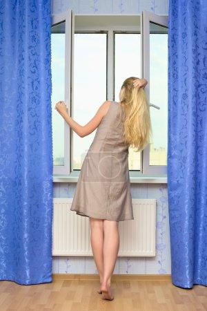 Beautiful Girl Opening Window