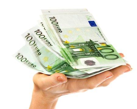 Stack money in female hand.