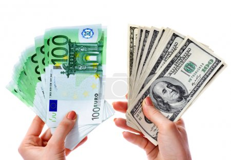 Exchange dollars to euro money in female hand.