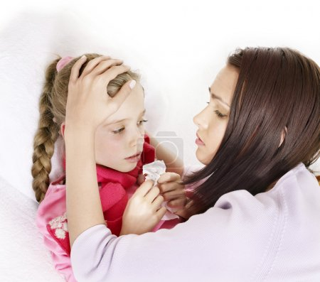 Sick child with mother. Isolated.