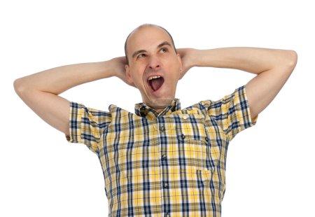 Portrait of sleepy man yawning