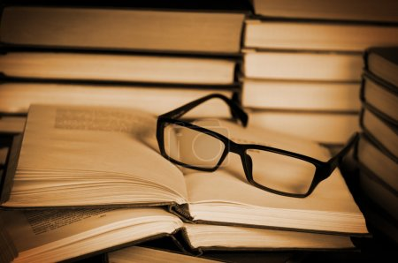 Photo for Glasses on open book. Concept of reading and education. - Royalty Free Image