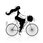 Girl with floral bouquet cycling