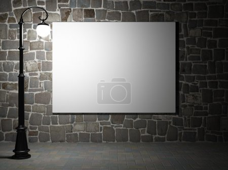 Photo for Blank billboard on a brick wall illuminated by streetlight - Royalty Free Image