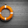 Lifebuoy attached to a wooden wall...