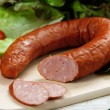 Smoked sausage on wooden cutting board...