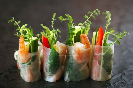 Vietnamese rice paper rolls with prawns and vegeta...