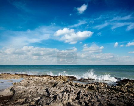 Photo for Waves breaking againt rocky coast - Royalty Free Image