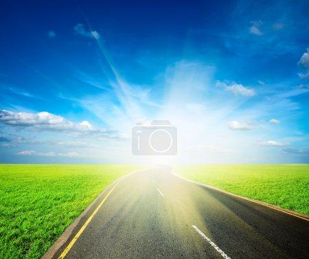 Road, field, sky landscape