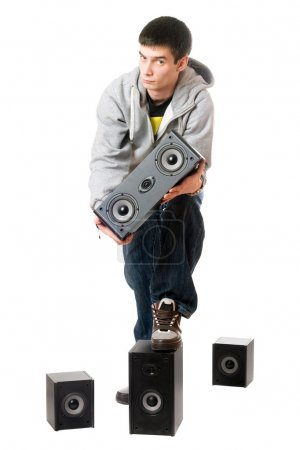 Young man with a speakers. Isolated