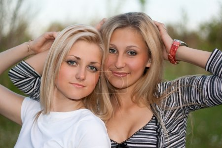 Closeup portrait of two attractive young women