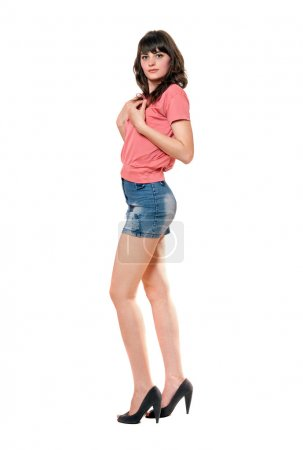 Photo for Lovely girl in jeans mini skirt. Isolated - Royalty Free Image