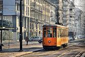 Old vintage orange tram on the street of Milan, Italy
