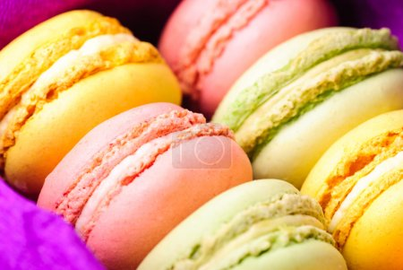 Photo for Macaroons in row close up in box - Royalty Free Image