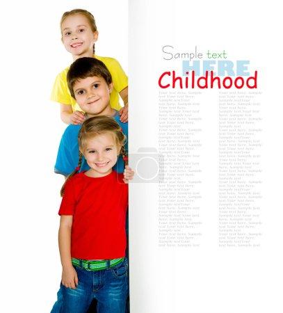 Photo pour Mignons petits enfants ower un fond blanc - image libre de droit