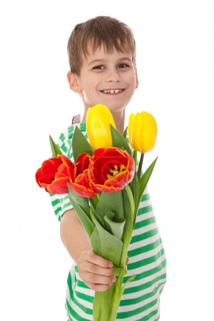Young boy holding tulips