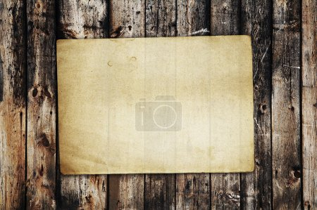 Photo for Vintage paper on old wood texture - Royalty Free Image