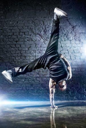 Young strong man break dance