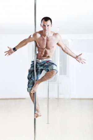 Photo for Young strong pole dance man. - Royalty Free Image