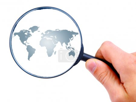 Man's hand is searching with magnifying glass