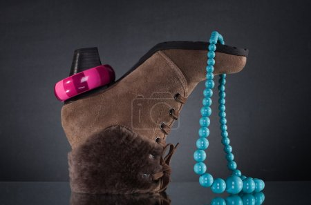 Women's winter shoes and jewelry.