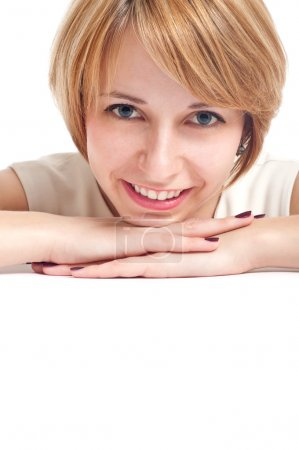 Photo for Close-up portrait of a smiling girl with blue eyes with white copy-space to paste your advert - Royalty Free Image