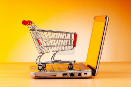 Photo for Internet online shopping concept with computer and cart - Royalty Free Image