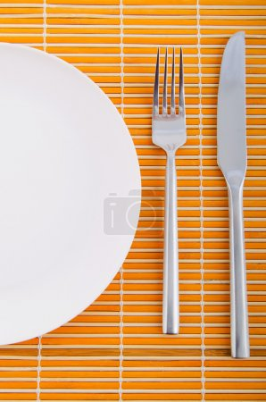 Emtpy plates with utensils on table...
