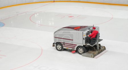Hockey stadium with machine for resurfacing ice