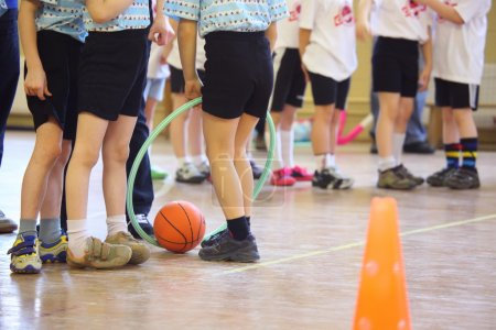 Photo for Children's feet in sports hall - Royalty Free Image