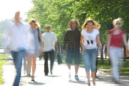 Passers-by in street in summer