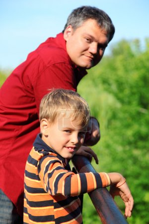 Photo for Man and boy outdoor in summer - Royalty Free Image