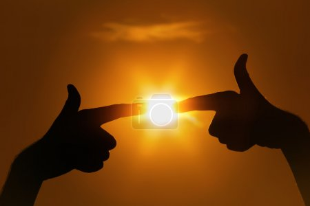 Fingers pointing to sun gesture