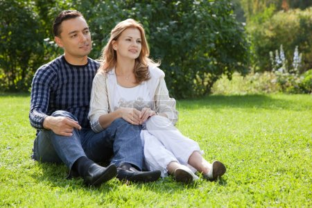 Married couple looking aside outdoors