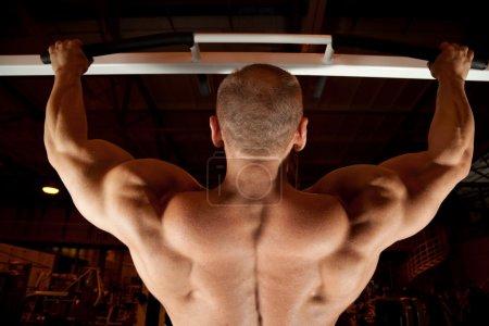 Bodybuilder back in training room