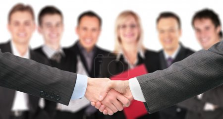 Shaking hands with wrists and six business group out of focus co
