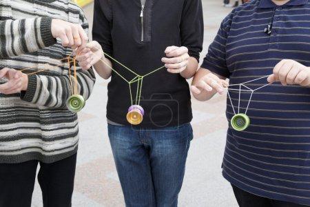 Teens with yo-yo toys