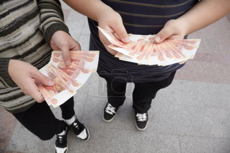 Two teens staying with funs of russian roubles in ...