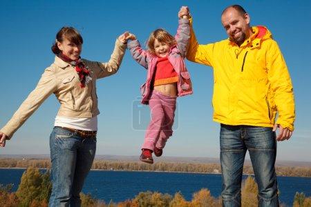 Family of four sunny autumn day