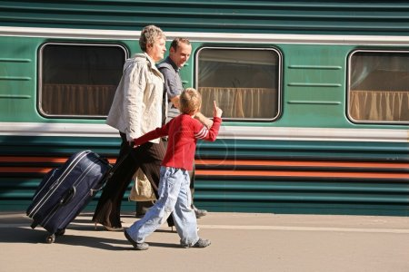Grandmother and grandfather with the grandson on station