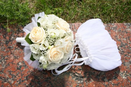 Bag and the bouquet of the bride