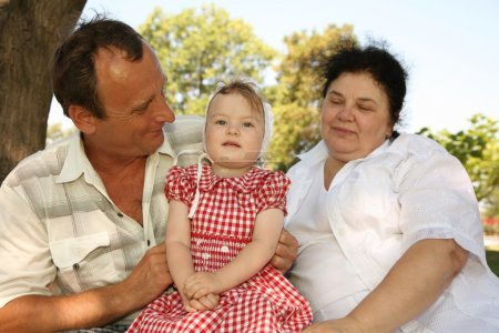 Grandmother with grandfather and granddaughter