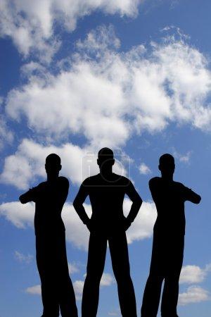Three silhouette on cloud sky