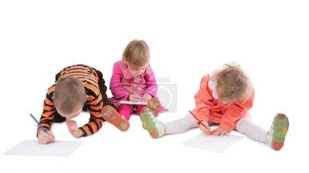 Three children drawing 3