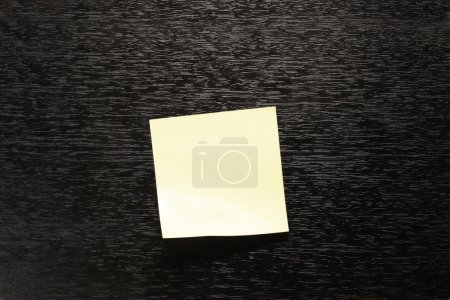 Yellow paper sticker on black background