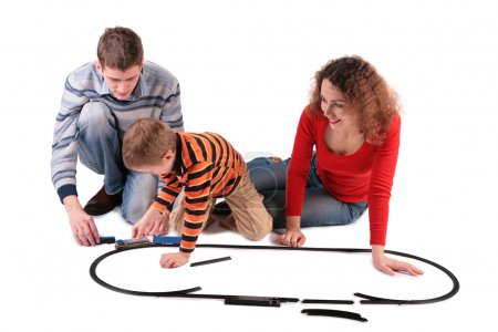 Photo for Parents play with son in toy railroad - Royalty Free Image