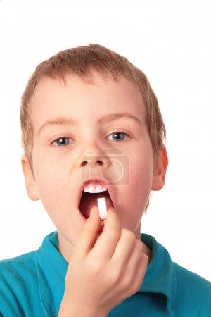 Boy swallows pill