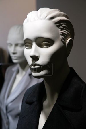 Two mannequins in jackets