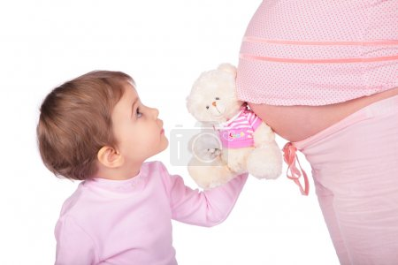 Little girl with toy and pregnant