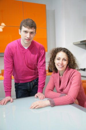 Young couple on kitchen